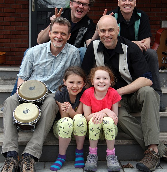 Hey Buster members Sherwood Lumsden, Stephen Skoutajan, Tom Stewart, and Matt Young along with Kate Young and Sophia Skoutajan. Hey Buster is very much a family affair. Young's daughter Kate is featured in the last song on their latest CD, So Long, So Long Goodbye. Skoutajan's daughter Sophia was a dancer in the Mayfair show, and her mother Elizabeth was the choreographer for the dancers. Lumsden's son Thomas did the illustrations on the CD and Stewart 's son, Johnny, does sound at shows. Photo by Andrea Cranfield.
