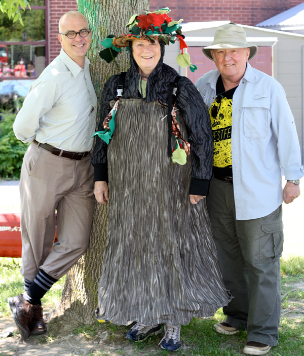 """Jean McKibbon, Westboro Community Association's """"tree rep"""" dresses as the Kitchissippi Tree Mascot at Dovercourt's Wild West Garage Sale on June 6. She is joined by Councilor Jeff Leiper (left) and WCA Chairman Norm Morrison. Photo by Anita Grace"""