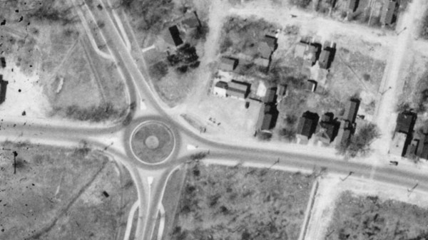 Aerial photo of the property from 1933, showing the original gas station.