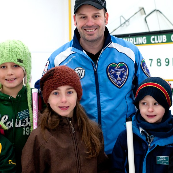 Visiting pro curler Jean Michel Menard inspires young Little Rock team at the Granite Club. Photo by Kate Settle.