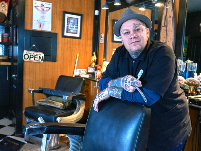 """""""This is where I hope to be cutting hair when I'm eighty-five,"""" says Devon Hayter, the man behind the chair at The Brooke. """"I hope to pass this on to someone else who will keep this as a barber shop."""" Photo by Ellen Bond"""