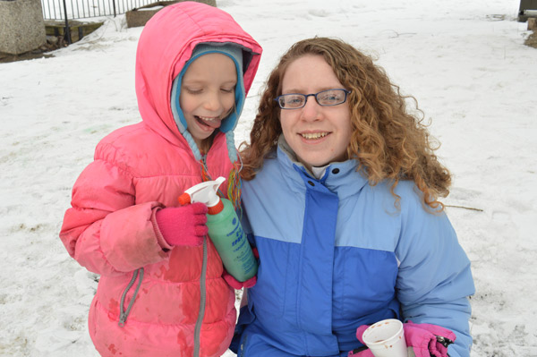 """Kitchissippi residents Patty Mosher and her daughter Kayleigh Mosher, 6, spent some time decorating an igloo with coloured water. Patty has been to the carnival before and reading about it online served as a timely reminder. """"I was looking online for Winterlude events and I found this."""""""