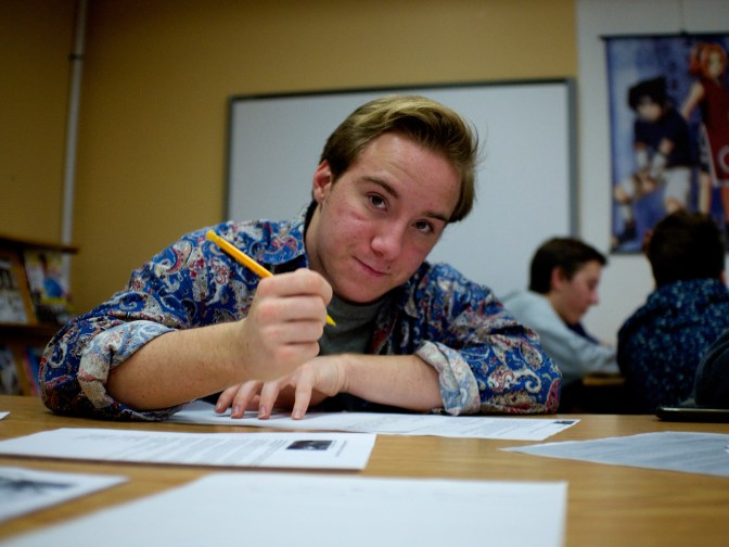 Nepean High School students put pen to paper for an Amnesty International letter-writing event. Photo by Zoe Krovac