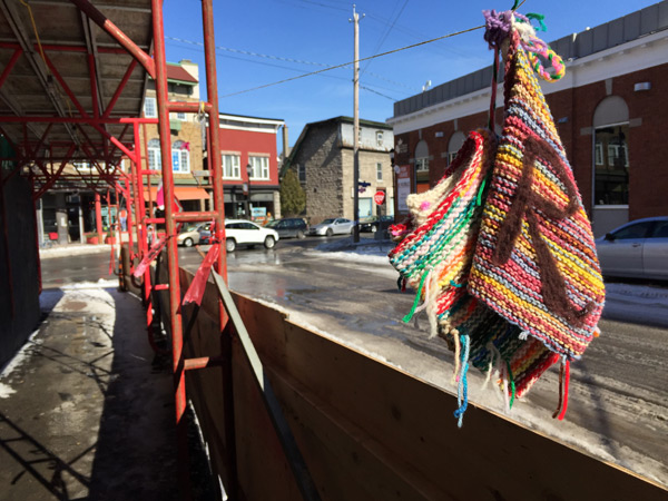 """The Rosemount Avenue Branch of the Ottawa Public Library was """"yarn bombed"""" on March 14. Knitters from across Kitchissippi Ward and the city created over one hundred and seventy-five knitted books and hearts to illustrate their love for the library. Photos by Andrea Tomkins"""