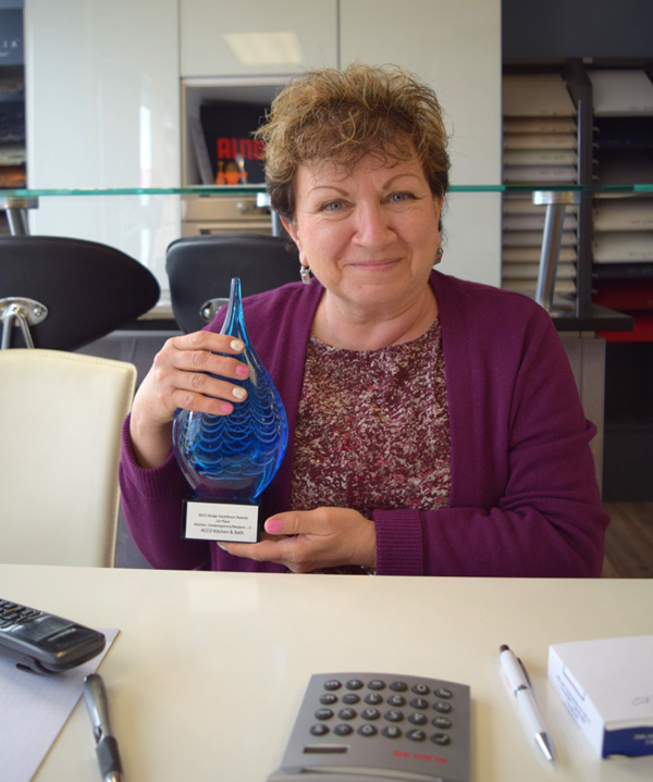 Fanya Zilberbrant, owner of ACCO Kitchen and Bath, with her recent national award. Photo by Alyson Queen