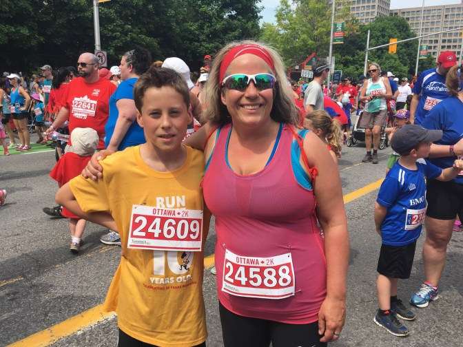 Lisa Georges is the race director for the Cyclelogik Hintonburg Centennial 5K Run/Walk & Newswest 1K Kids' Run, which is taking place July 10. She's pictured here with her son Evan.