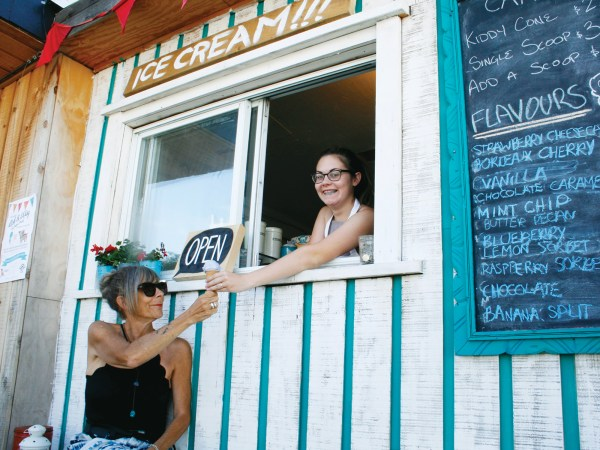 Tallie Doyle scoops a frozen treat for her mom, Andrea Stokes. Cardinal Ice Cream was one of many new shops that opened their doors in Kitchissippi this summer. Photo by Jacob Hoytema