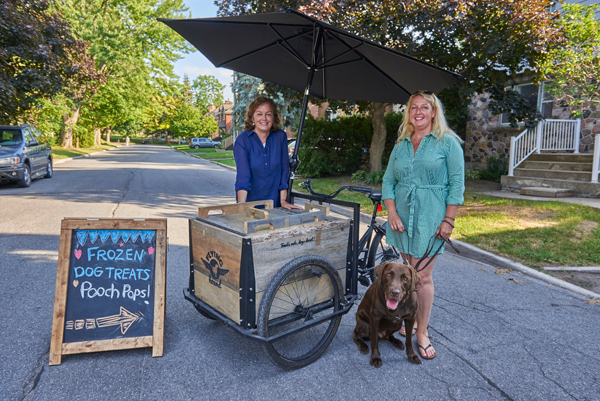 "Karen Gibson and Grazyna Szawlowski with their ""treat trike."" Photos by Ellen Bond"