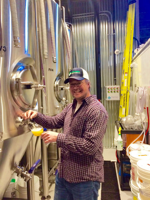 Tooth and Nail Brewing Company owner Matt Tweedy pours a fresh sample. Photo by Shauna McGinn