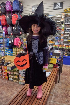 Luciana dressed as a witch.