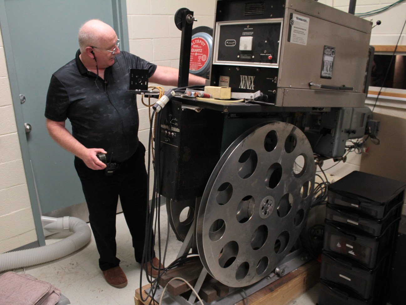 Projection operator Julian Gumley demonstrates how to work the 35mm projector that the OFC used in its earliest days.