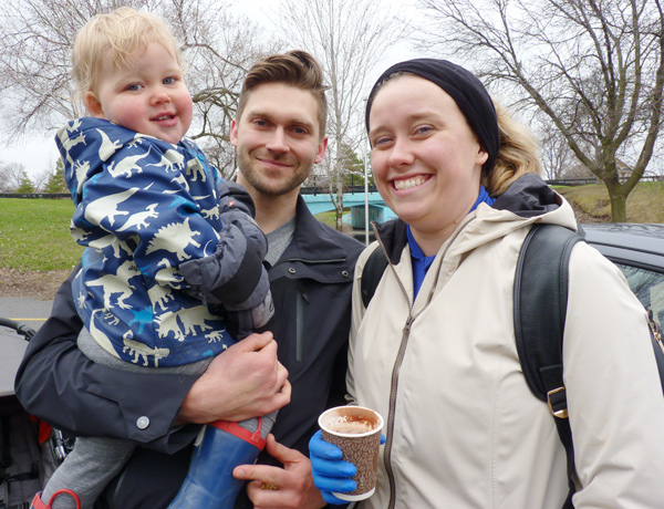 "Dustin Patterson and Lorne Skelly with their son, Jack: ""We're early risers. We enjoy it. It's good for [Jack], good for us. We spend a lot of time here in the summer. Every Friday evening we come down and listen to the band. We're big supporters of the Riverkeeper. What they do is important. It's part of our community."""