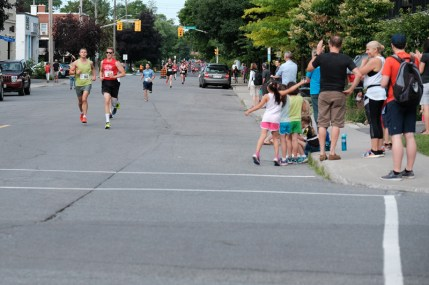David Dawson and Philippe Knetch lead a pack of runners through a cheering section at Spencer and Hamilton.