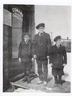 A photo from 1916 of Bert, Jack, Bill Eggens outside Lambert Eggens' grocery store. Photo courtesy of Lorraine Eggens.