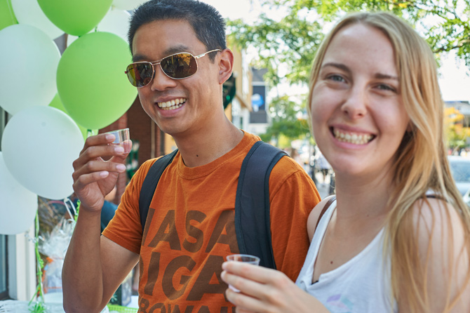 Hintonburg residents Kim Truong-Trieu and Kayla Wemt are enjoying their first time at the Tastes of Wellington West. Here they are tasting samples of natural electrolytes from Watson's Pharmacy & Compounding Center.