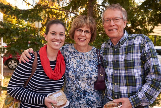 """Sarah Moffat, with friends Laurie and John: """"I come every week that I can because I live in the area. It's beautiful, it's part of the community, and there's nice food."""" Photos by Ellen Bond"""