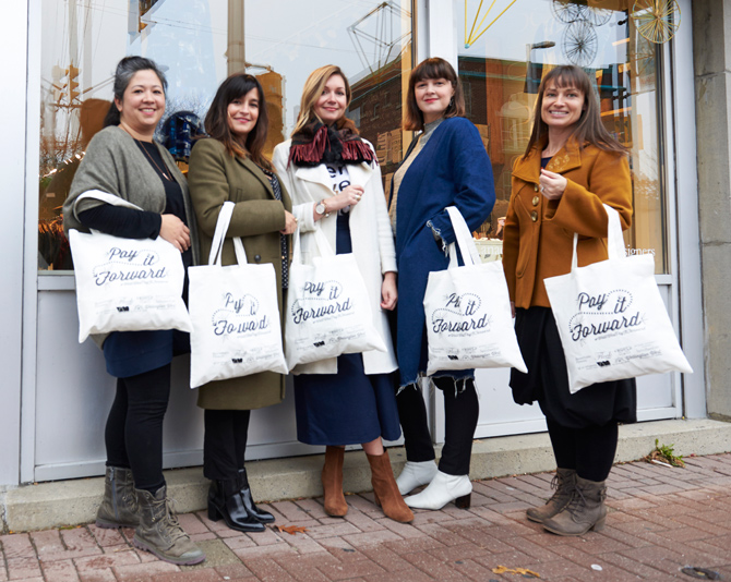 """Kitchissippi shoppers are encouraged to give back to the community with a """"Pay it Forward"""" campaign. Grab a tote bag, fill it for women in need, and drop it off at a participating retailer in exchange for a special gift. Photo by Ellen Bond"""