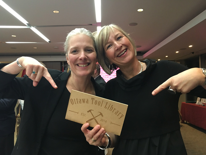 """MP Catherine McKenna (left) with Bettina Vollmerhausen, founder of the Ottawa Tool Library. OTL started three years ago and has become a valuable resource for all makers and doers. OTL is now hoping to expand. """"Initially we thought it would be in my garage, something small,"""" says Bettina."""