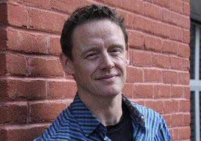 A headshot of Joel Harden.
