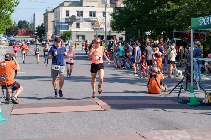 Sandra Sukstorf (left) with the face of determination, finishing 1st in their category: 00:25:17.2
