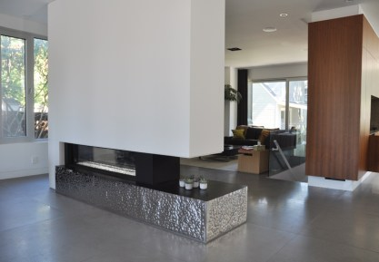 A stunning fireplace divides the open space. Photo by Andrea Tomkins