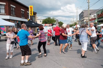 A round of square dancing breaks out at the corner of Richmond and Churchill.