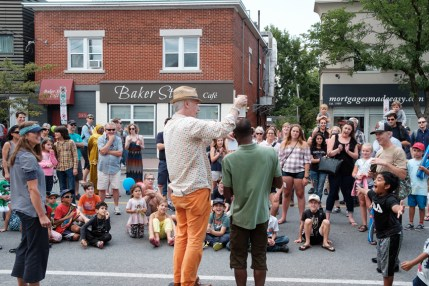 A crowd looks on in amazement at the climax of Chris Pilsworth's magic show