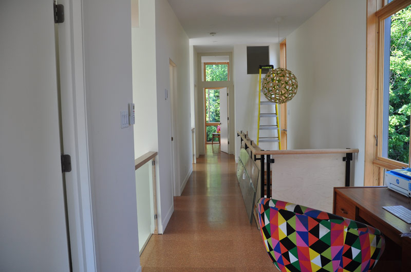 A bright hallway connects the three bedrooms upstairs. (There is still work to be done here.)