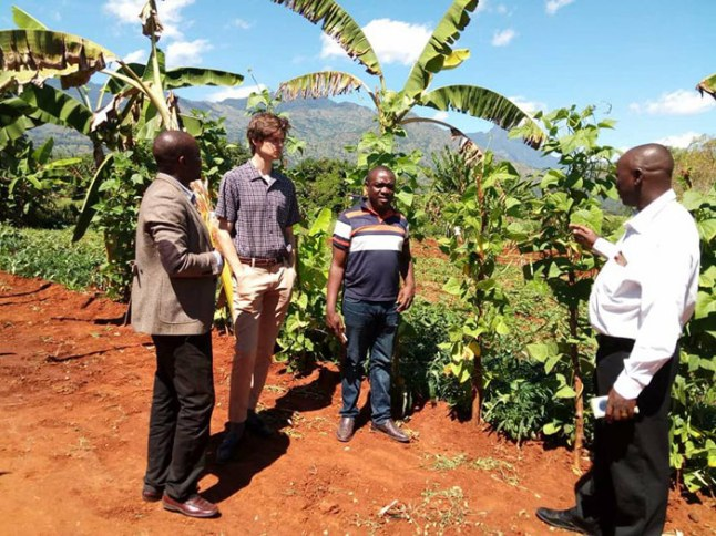 Jacob Hoytema, KT contributor, in discussion with his coworkers in Morogoro, Tanzania. On his summer volunteer internship with the Uniterra program, he supplied communications expertise to an agricultural collective there. Photo by Juditha Bernard.