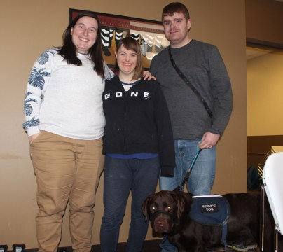 WAVE coordinator Caitlin Booth with Trisha and Connor, two WAVE apprentices. Also pictured is Connor's service dog, Charlie. Photo by Charlie Senack