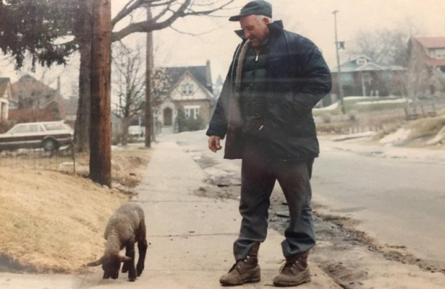 Known as the last chicken-keeper in the City of Ottawa, Harry Showler is shown here with his pet lamb walking down Granville Avenue. Photo courtesy of Jane Showler Doyle