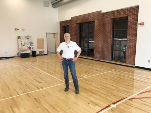 John Rapp, executive director of Dovercourt Recreation Association in the new space. The view of the pool is a thoughtful detail and lets some light in for the lifeguard staff and swim instructors, says John. Photo by Andrea Tomkins