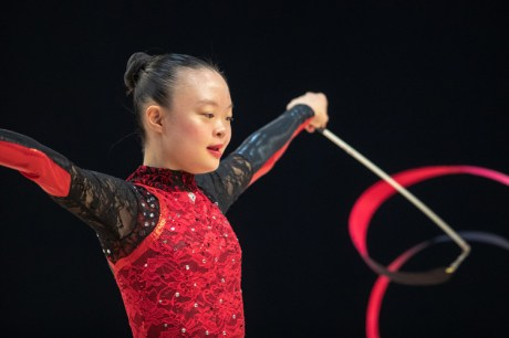 """Local Special Olympian Kimana Mar performing her favourite event, the ribbon apparatus. This is the only opportunity Kimana has to use her dominant left hand, making the ribbon """"extra special."""" Photo courtesy of Special Olympics Canada."""