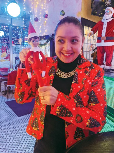 Miriam Lautru, the operations manager at the Savoy holds up an elf surrounded by Christimas decorationsready for Miracle Pop-up at the Savoy