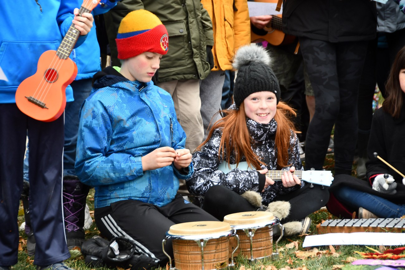 Two students from the School of Rock program at Churchill Alternative School prepare to play during this year's Remembrance Day ceremonies in Westboro. Photo courtesy Helen Flaherty, Westboro Legion