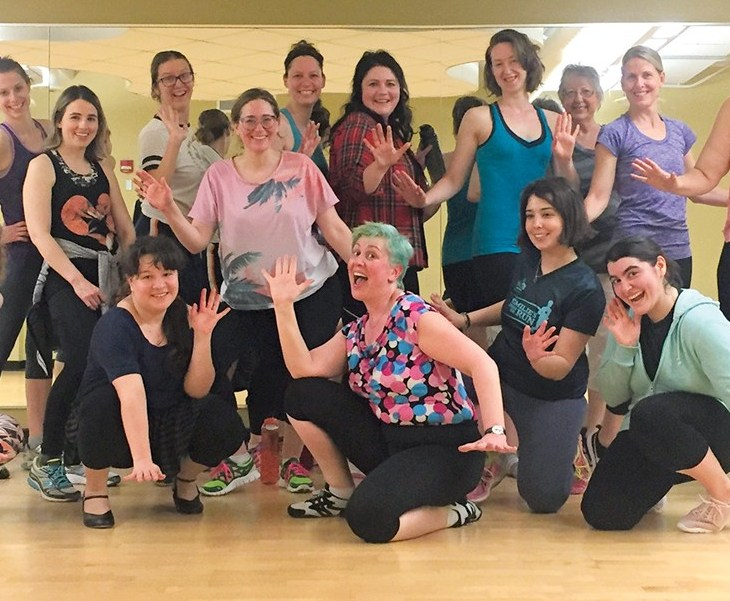 Participants in the Hintonburg Community Centre's Broadway Workout. pose for a photo.
