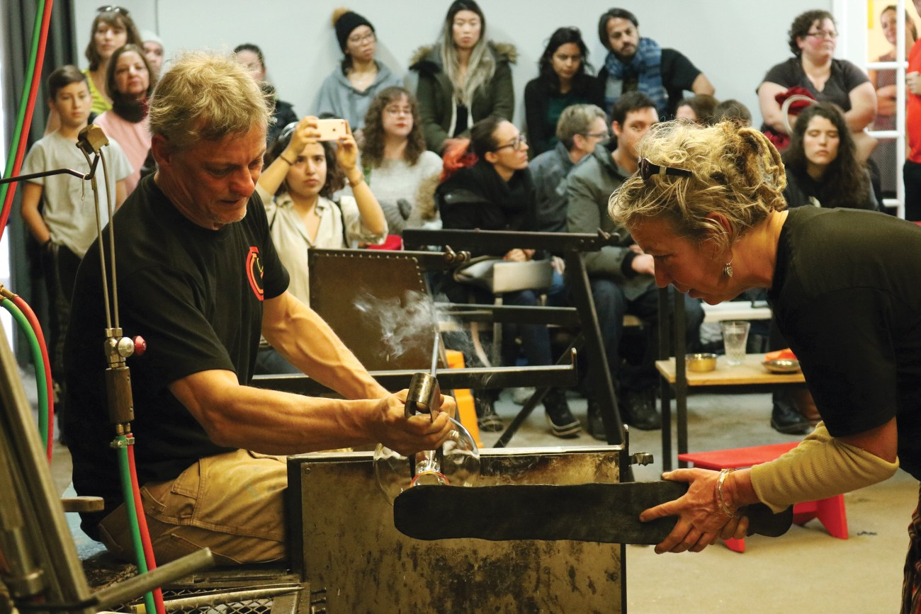 Expert glassblower put on a demonstration of their work for a crowd during the Ottawa Glassblowing Cooperative's grand opening in November.