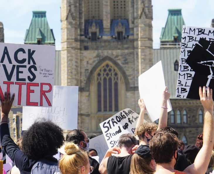 "Image description: Thousands gathered in Ottawa for the ""No Justice, No Peace"" anti-racism solidarity march."