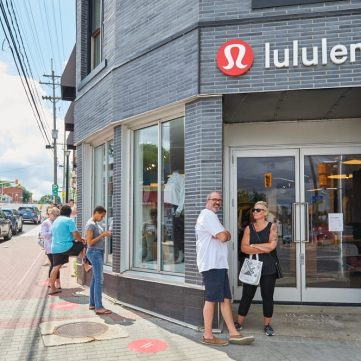 Locals maintain safe distance while in line outside of lululemon in Westboro. Photo by Ellen Bond.