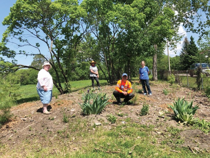 A photo of the Westboro Beach Community Association at the pollinator garden.