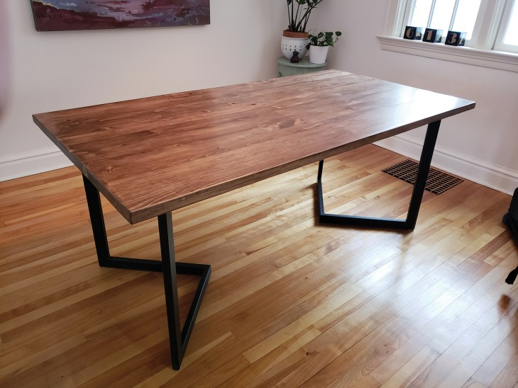 A photo of a pine table with Chevron style legs made by Maker House.