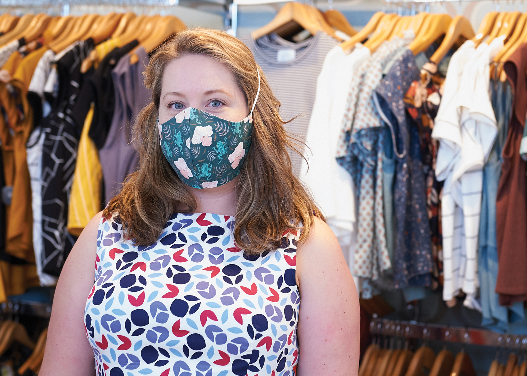 A photo of Helen Peterson wearing a mask at Flock Boutique in Westboro.