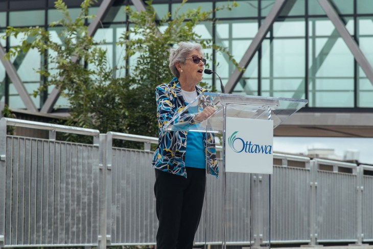 Former Mayor Jackie Holzman speaks at a podium in Ottawa.