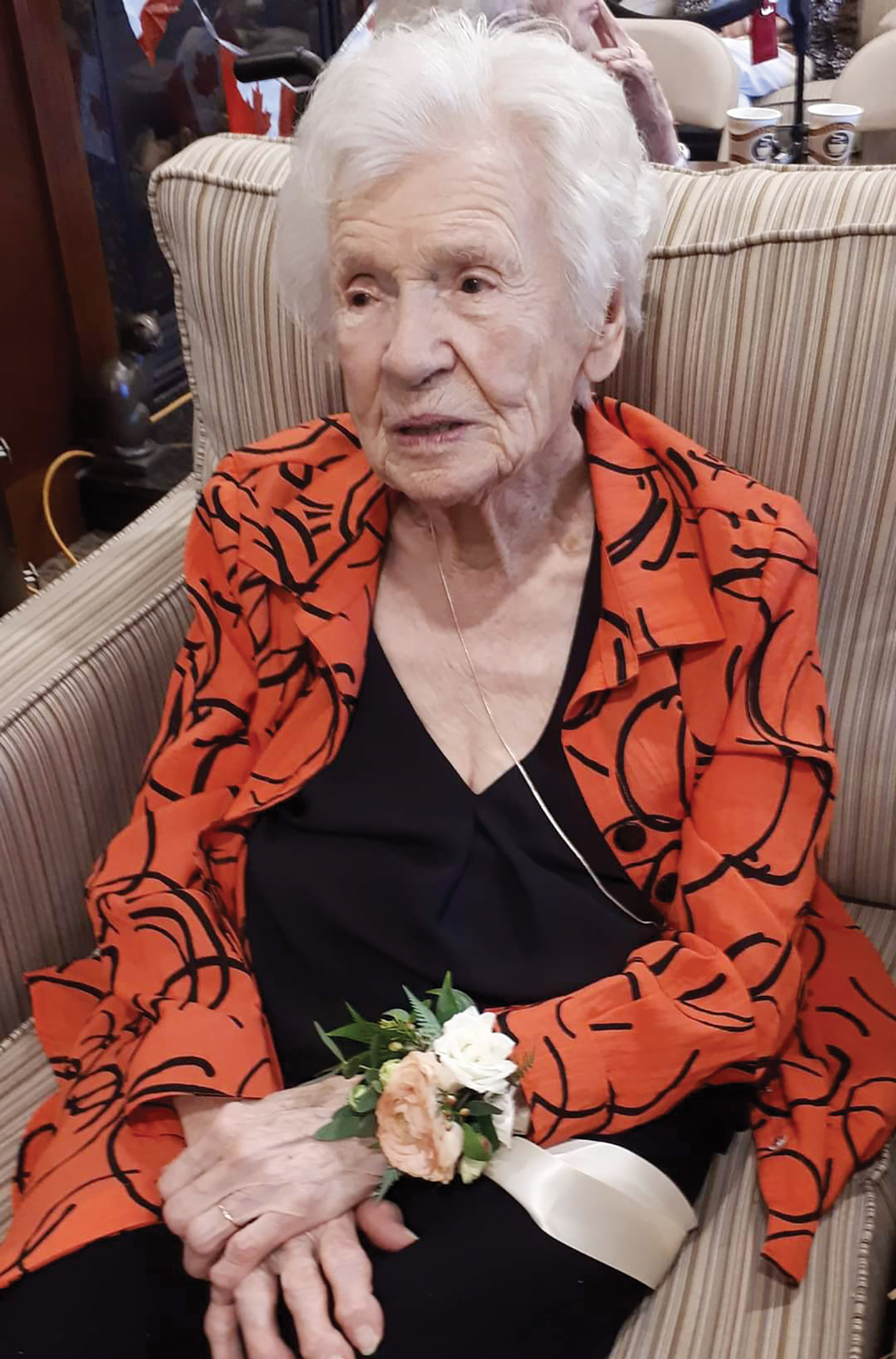 A photo of Ida Crocker sitting in a chair at her 99th birthday.