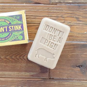 "A white bar of soap with the words ""Don't Be A Pig!"" stamped in."