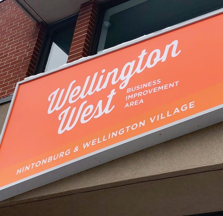The bright orange sign at the Wellington West BIA building