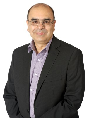 A headshot of Dr. Raj Bhatla against a white background