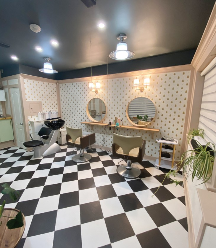 The inside of ApartMint Hair Studio in Hintonburg with a black and white checkered floor and white walls