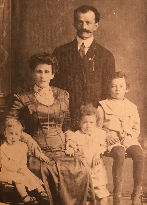 A sepia tone photo of the Lieff family is seen in 1910