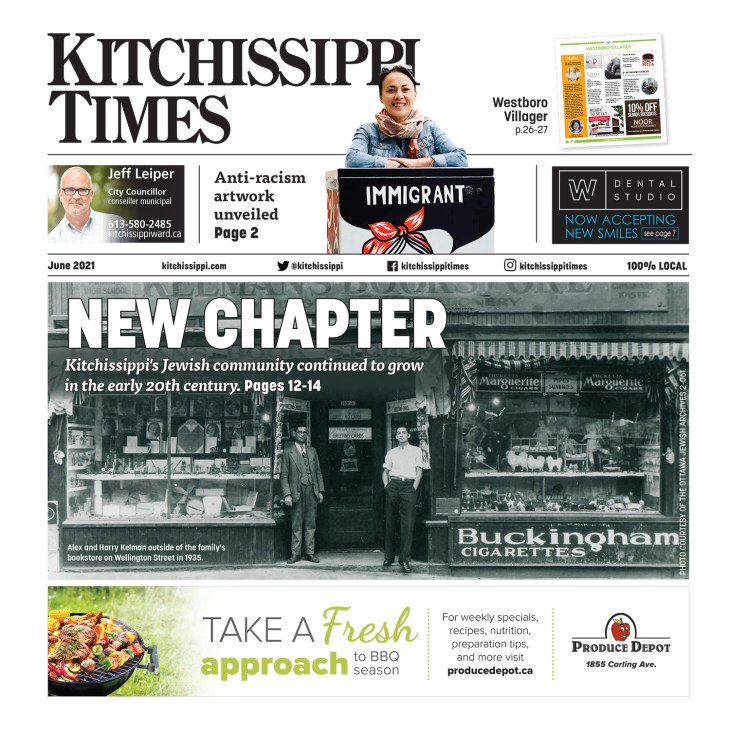 THe June 2021 front page of Kitchissippi Times is seen with a black and white photo of two men standing in front of Kelman's Bookstore pictured.